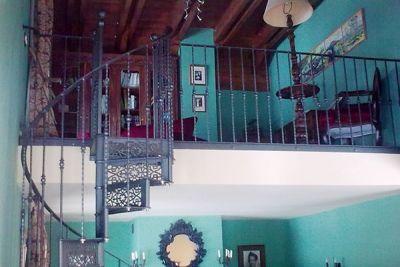 Escalera de caracol realizada en forja artística